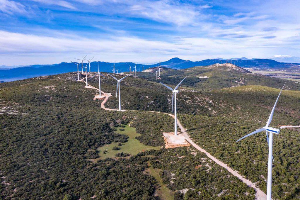 wind-turbines-renewable-energy-on-a-green-hill-win-PUCR2VL.jpg